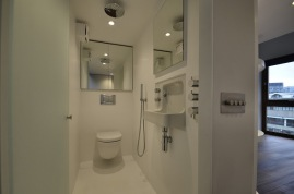 Below the mezzanine is a compact shower room that doubles as an en-suite WC, taking it's inspiration from nautical space saving Shower/WC cubicles found on yachts. The shower drain is a neat slot below the wall hung WC.