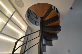 The design of the spiral staircase matches the existing black metal balustrades of the flats main staircase; the folded metal and hardwood tread design being taken from an original Barbican spiral staircase found in John Trundle Court which we used as a reference.