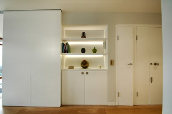 This cupboard conceals the broadband hub as well as a Sonos wireless audio system.