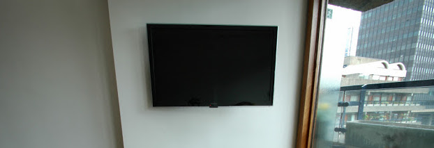 The TV is mounted on a swing out wall bracket.