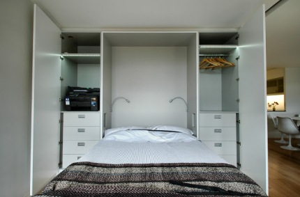 To the left of the bed is handy study storage with space for a printer, stationary etc. On the right the wardrobe provides hanging space and drawers for clothes when the guest bedroom space is deployed.
